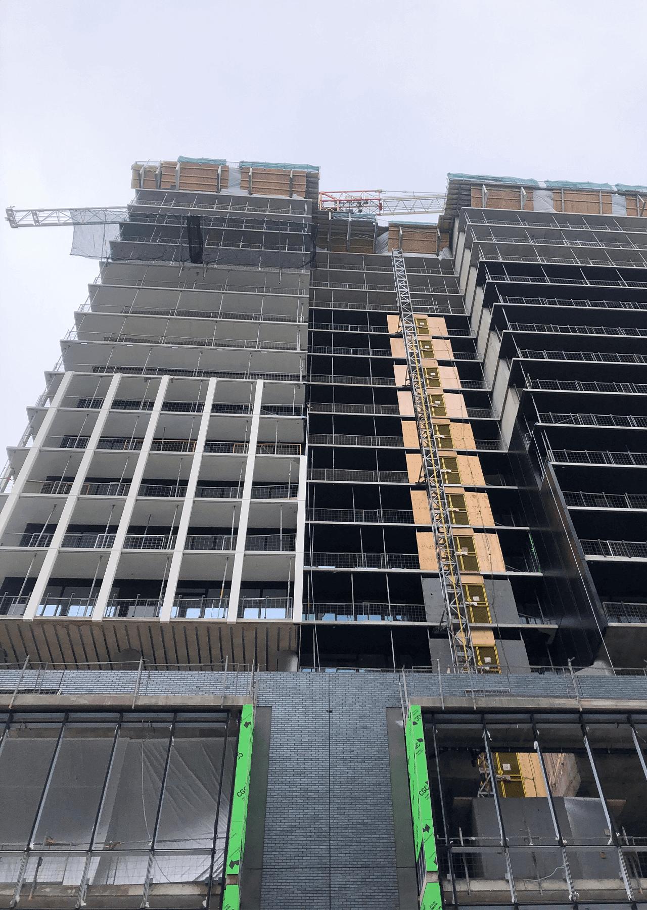 building under construction installing windows