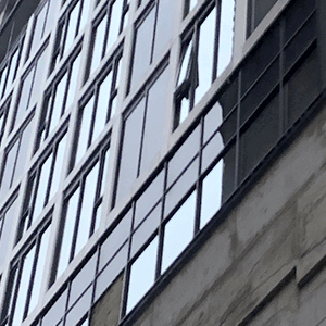 close up of windows on a building that is under construction